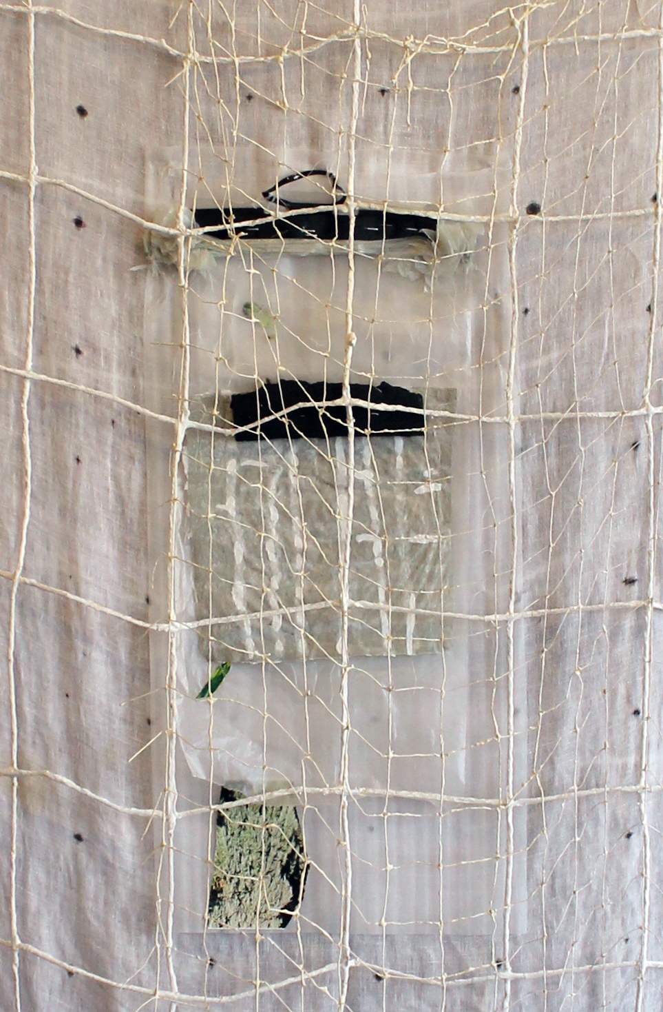 Dorie Days , detail, Harriet Hoover, 2015, paper, gouache, digital print, Amy Hoppe's handmade paper, electric tape, plastic, foam, cotton rope, cotton table cloth.