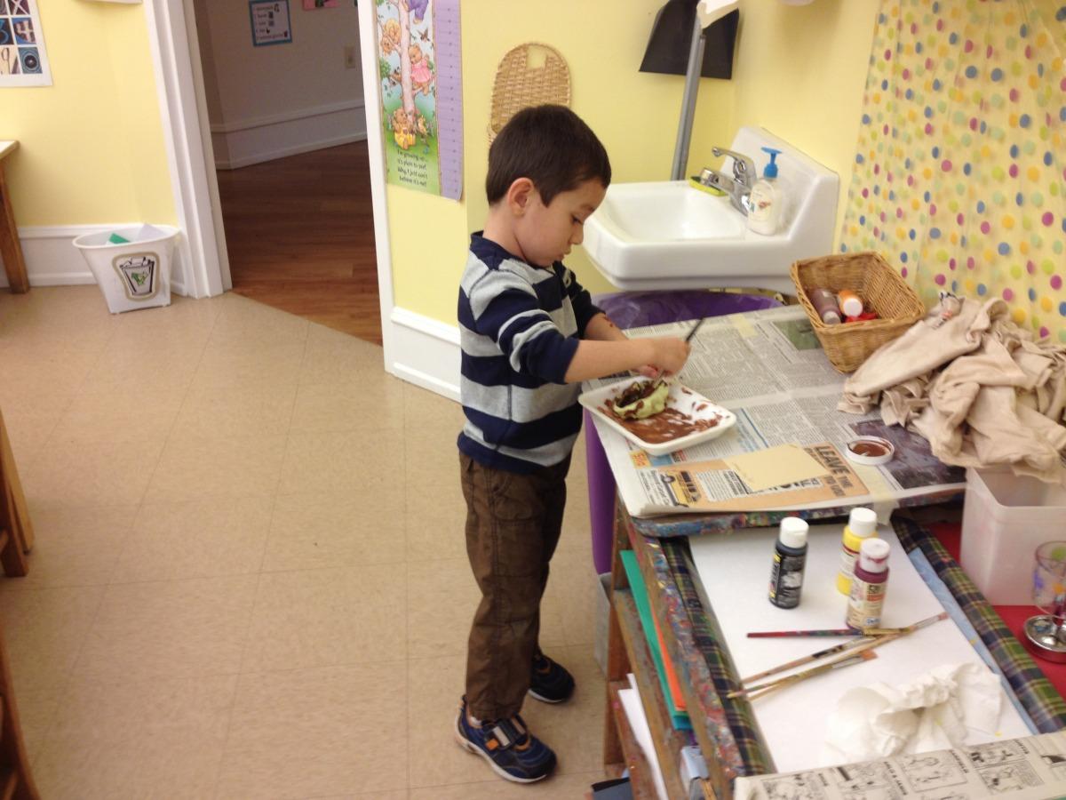 painting a Lenape cooking pot