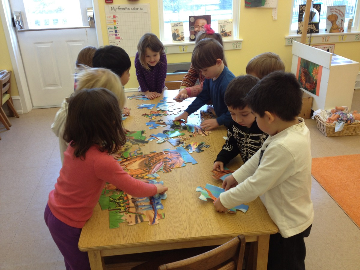 working together on a huge puzzle