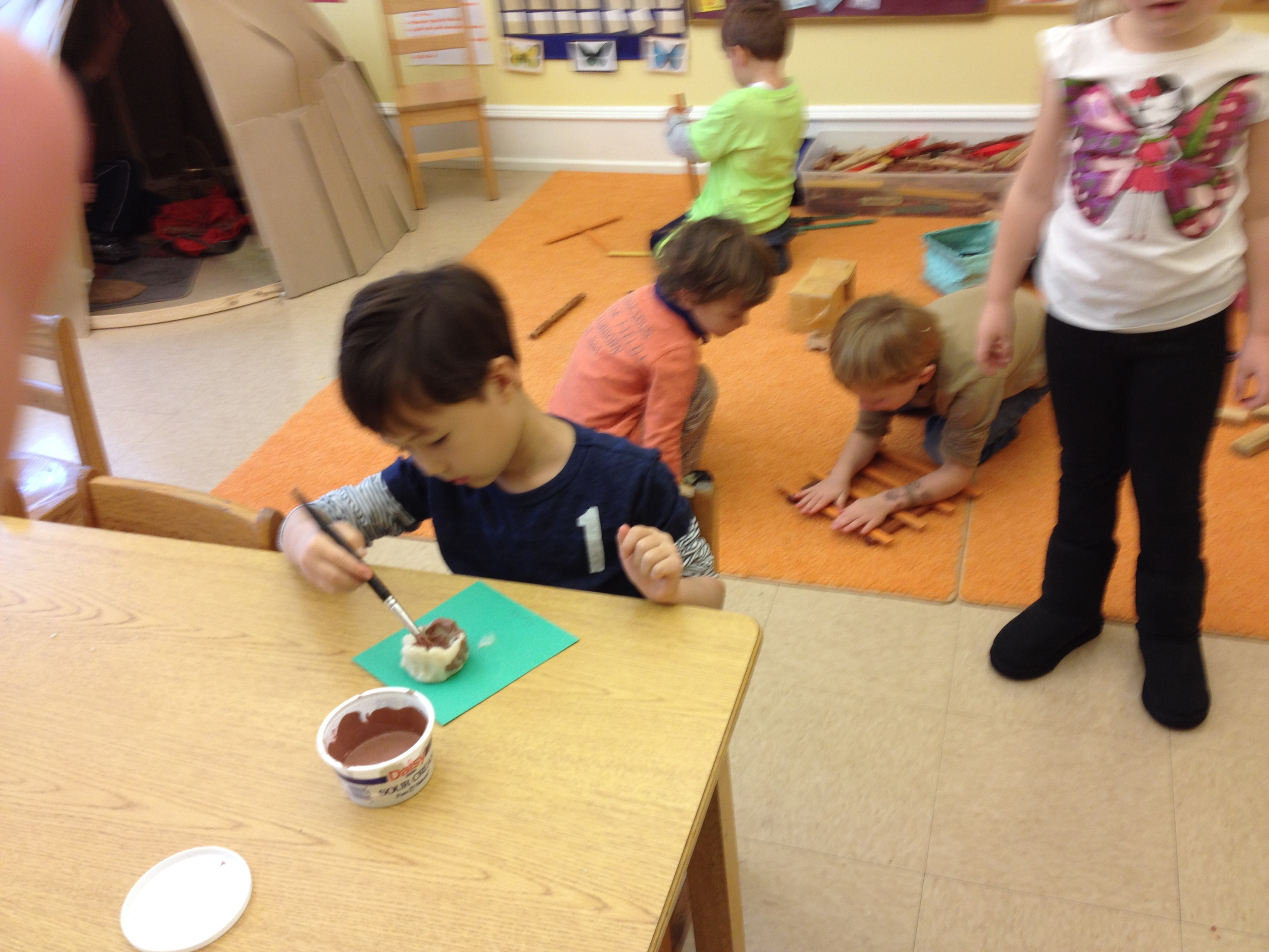 painting a Lenape clay pot