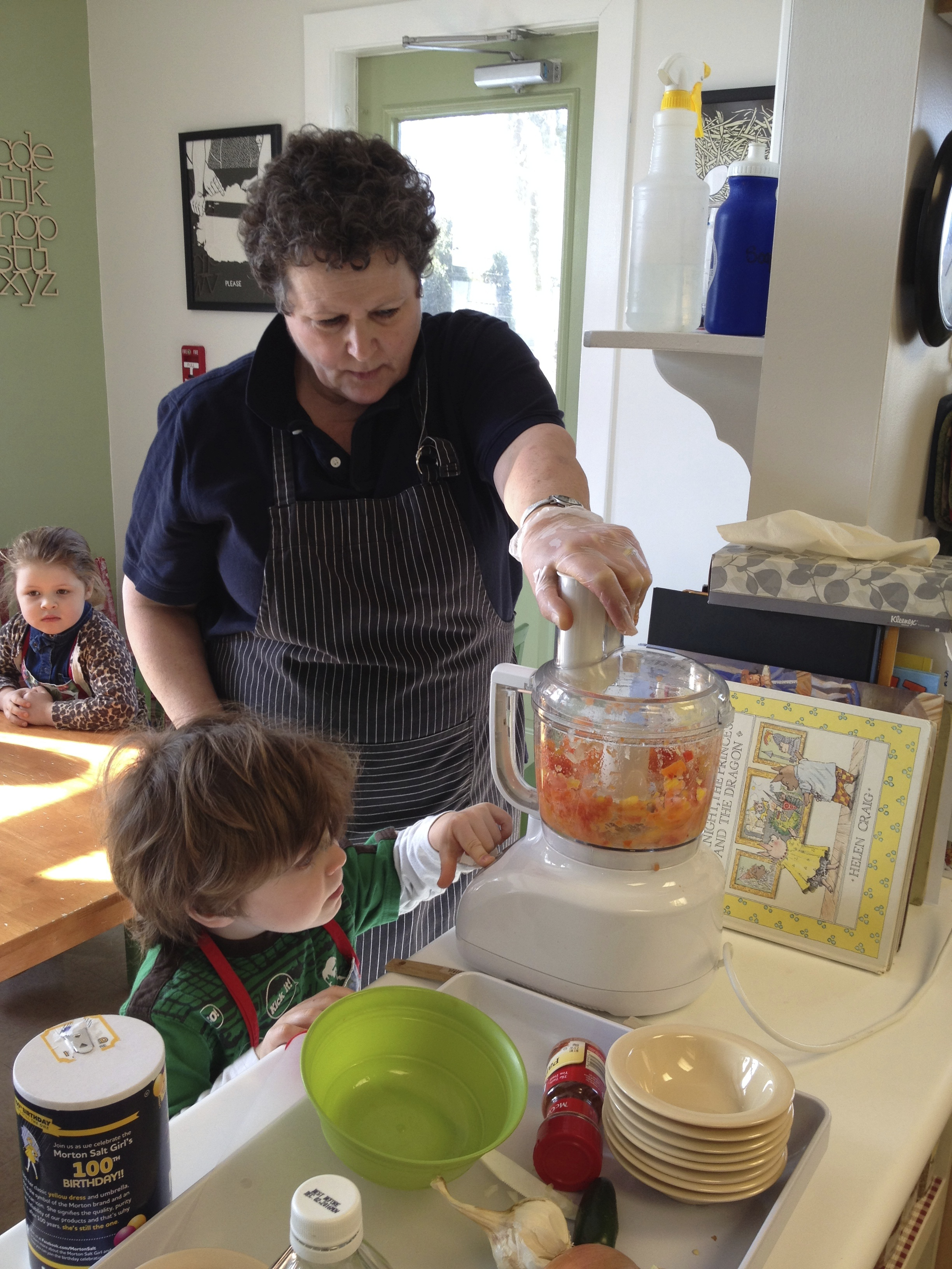 ...then we chop peppers, tomatoes and onions in the food processor...