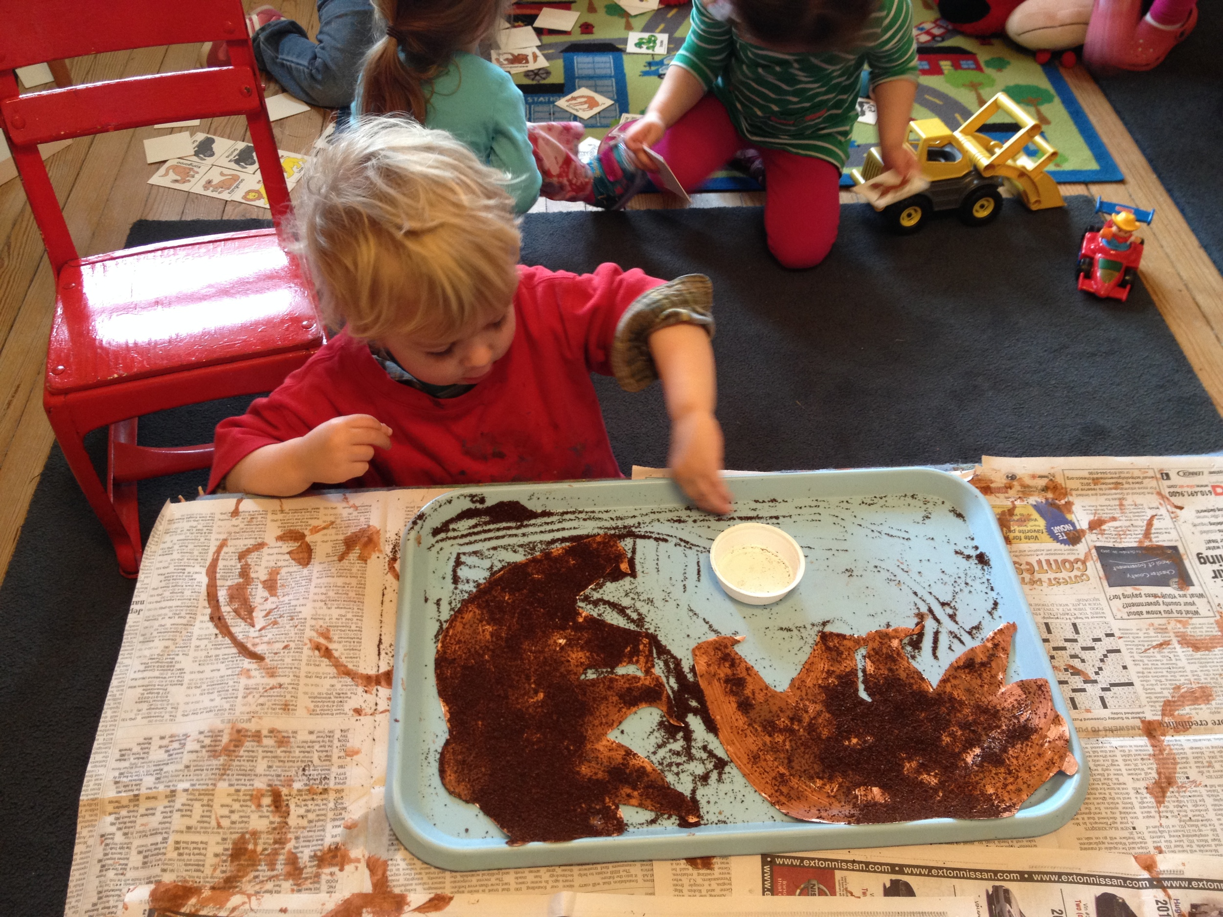 Pinching and spreading coffee to make a bear- good fine motor skill development!