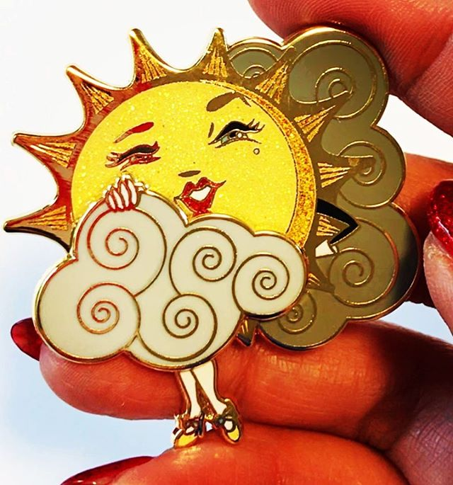 "I am over the moon for my new pin design. Just arrived today and is available in my shop. (Link in bio). My very first sliding pin. Based on my original illustration ""Sun Teaser"" ©KitschyDelish™️, 2019. Move that cloud! 🌤"