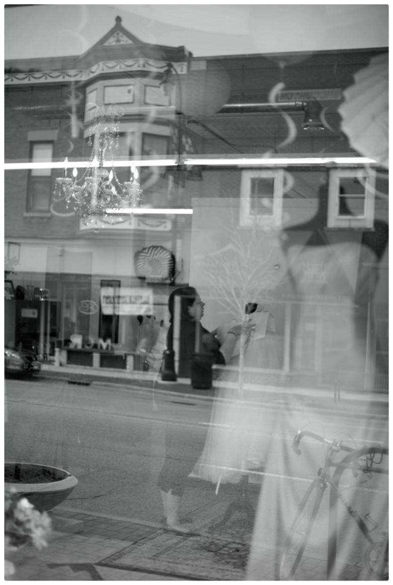 Shop Owner Marissa prepare a window display
