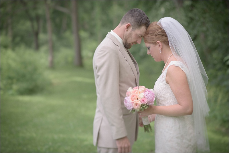 M & P in prayer before their wedding in Kingston, IL.