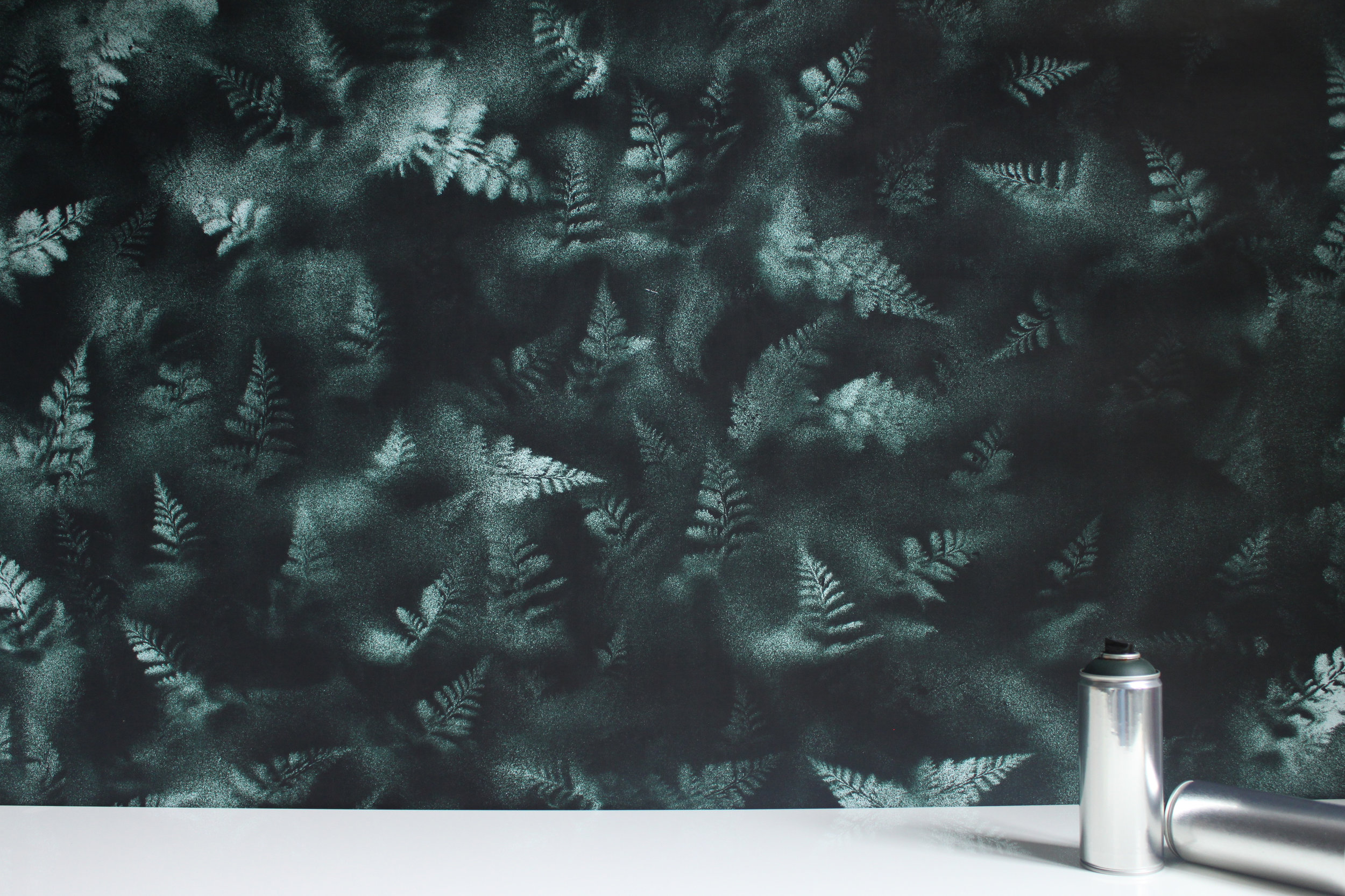 """FERN   FROM AN ORIGINAL SPRAY PAINTED ARTWORK, FERN CREATES A LAYERED, ETHEREAL BOTANICAL PORTRAIT  AVAILABLE IN FOREST GREEN OR BLACK  DIGITALLY PRINTED ON EITHER:  CLAY COATED PAPER (CLASS A FIRE RATED) - REPEAT 54"""" HORIZONTAL, 61"""" VERTICAL  SCRIM BACKED PVC FREE PAPER (CLASS A FIRE RATED - SUITED FOR HEAVY TRAFFIC)  MINIMUM ORDER 50 SF  LEAD TIME 4-6 WEEKS  $11-26/SF"""