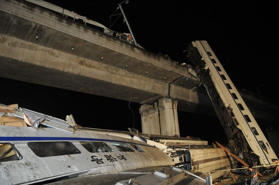 After the collision, four cars of the rear train fell off the Ou River bridge, slamming into the ground more than  66 ft.