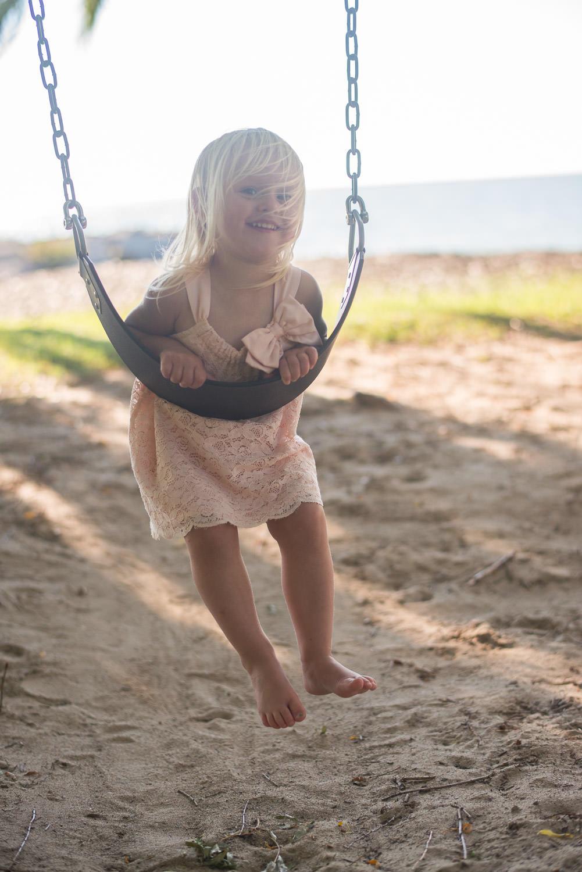 beach-girl-playing-on-swings.jpg