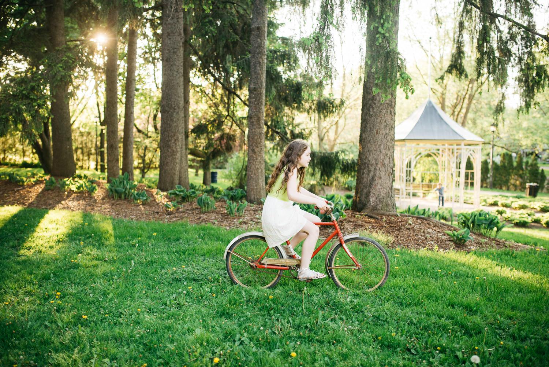 girl-riding-bike-through-park.jpg
