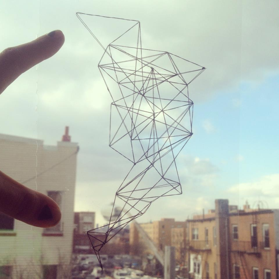 Urban Landscape   Acetate, black nylon thread, against glass in Bushwick