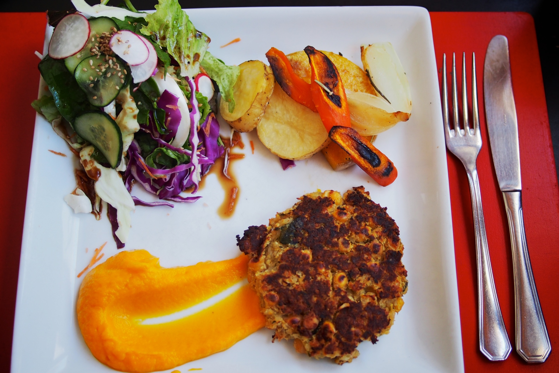 Chickpea patty with roasted veggies, squash purée and a salad from Casa Covita