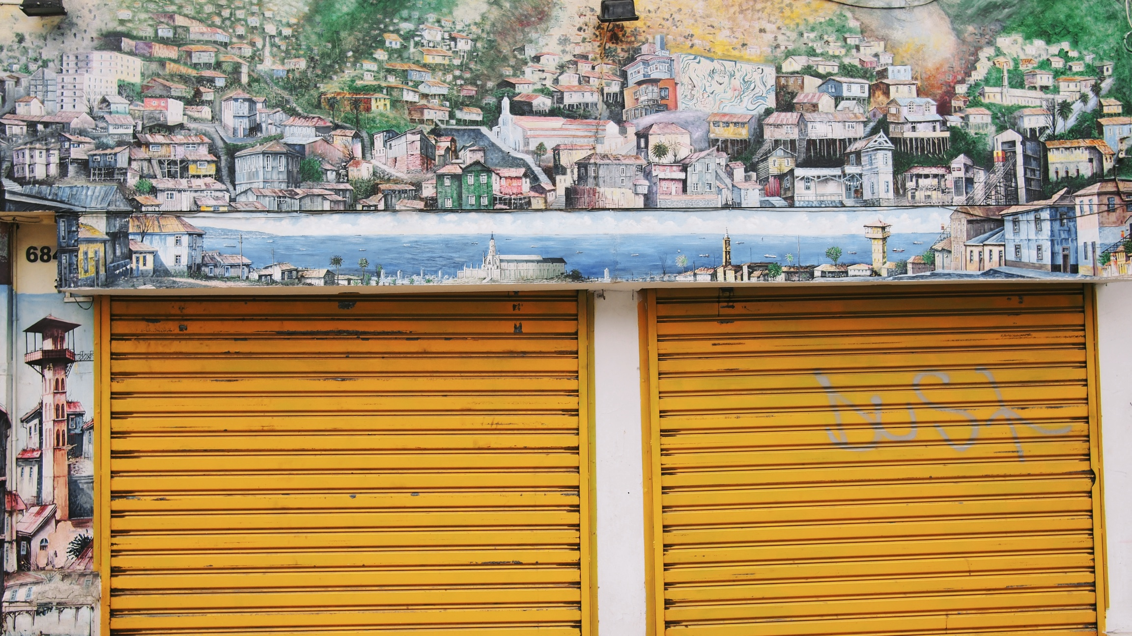 Above and below, some of the interesting artwork adorning the streets of Valparaíso