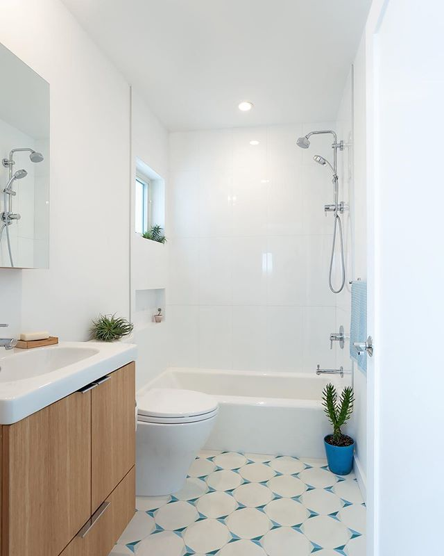 A kids bathroom that is both beautiful and functional. Handmade cement hexagon tile from cle tile, custom grain-matched white oak floating vanity, all Ultrex Marvin Integrity window, and a skirted Toto toilet for ease of cleaning.