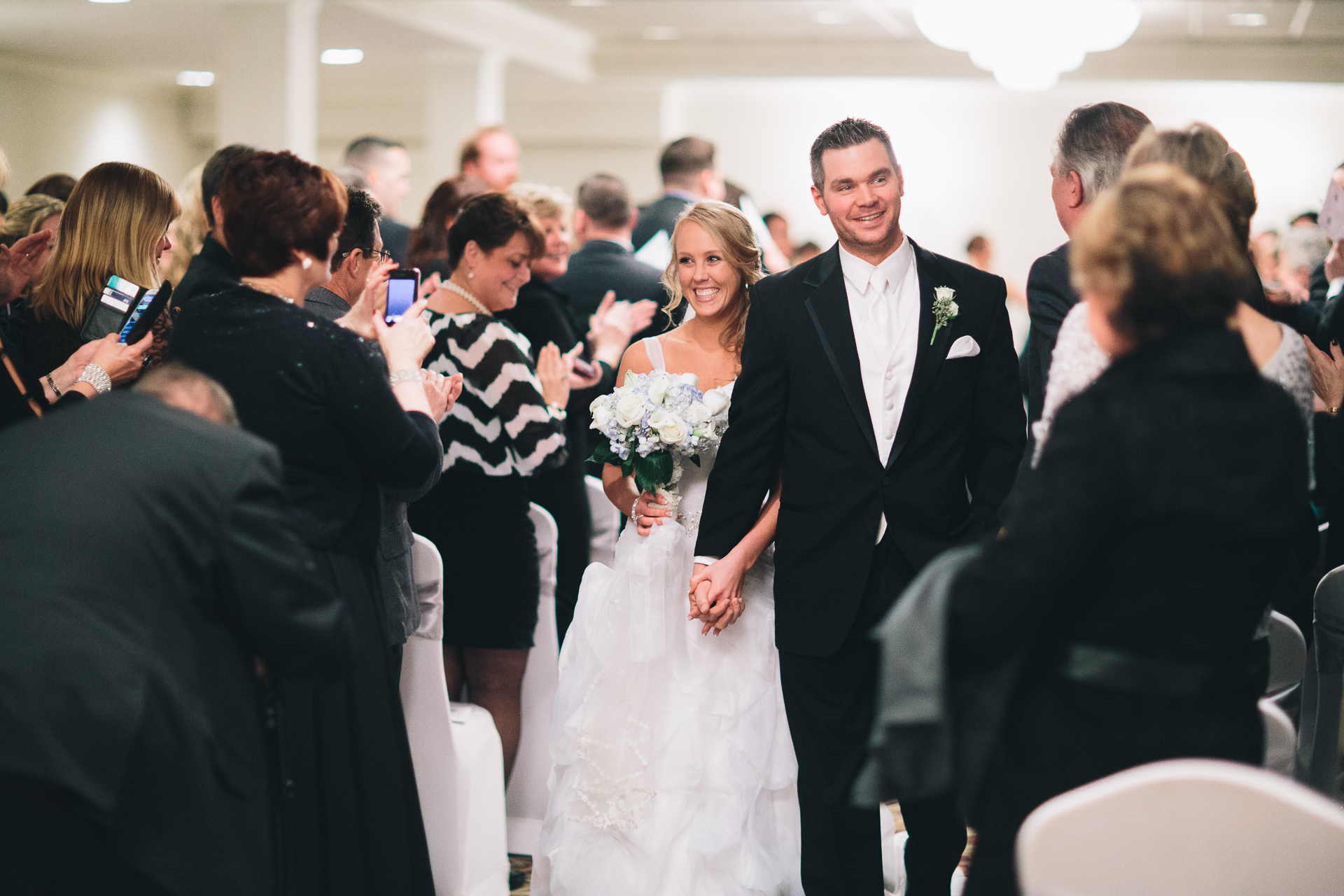 Newlywed couple walking down the aisle!
