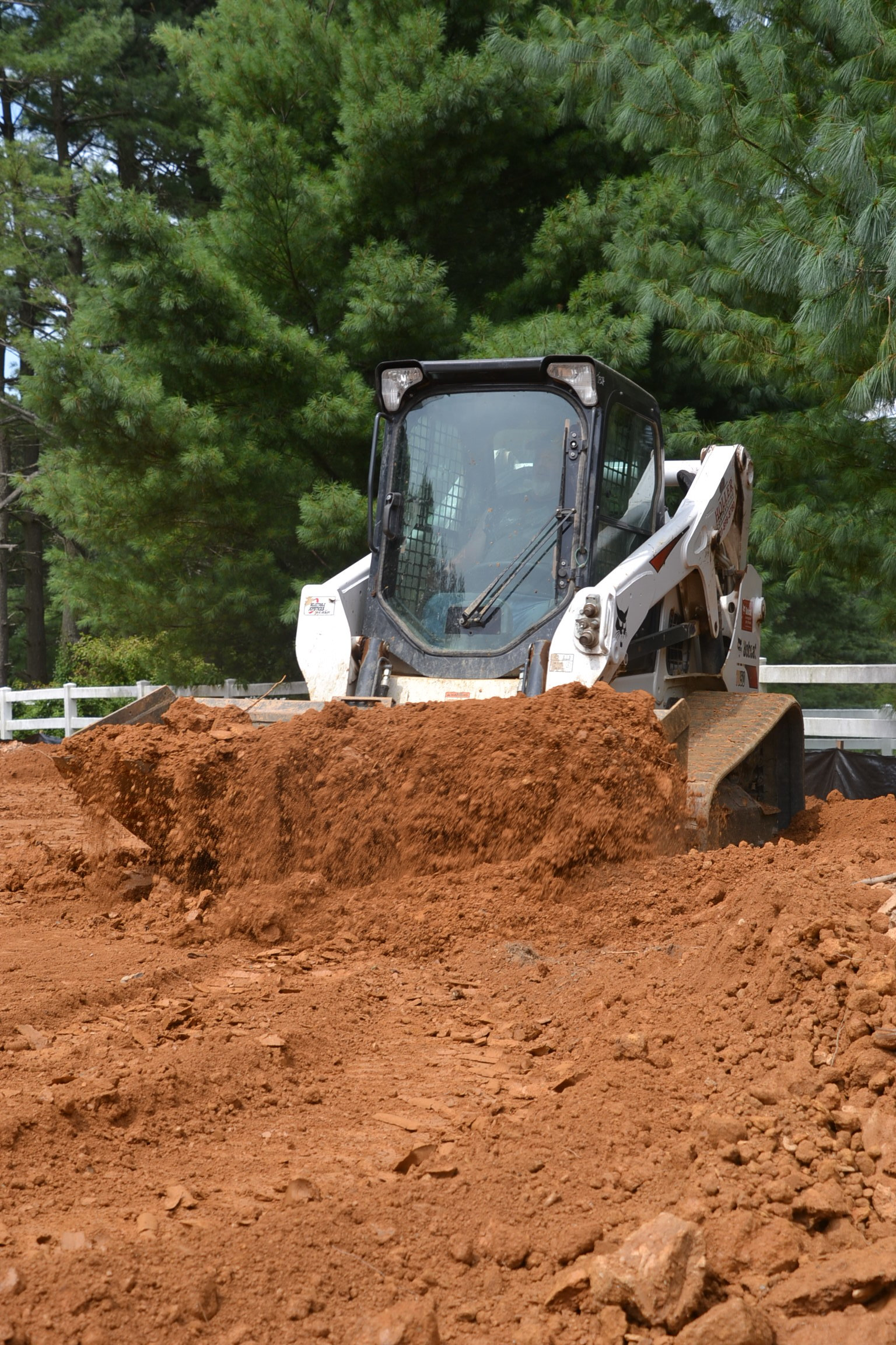 hauling in dirt and compacting for an upcoming pole building expansion - Woodbine, MD