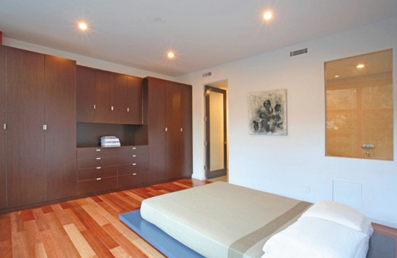 Master bedroom features Kempas indoor wood flooring and Wenge veneer for all custom cabinetry.