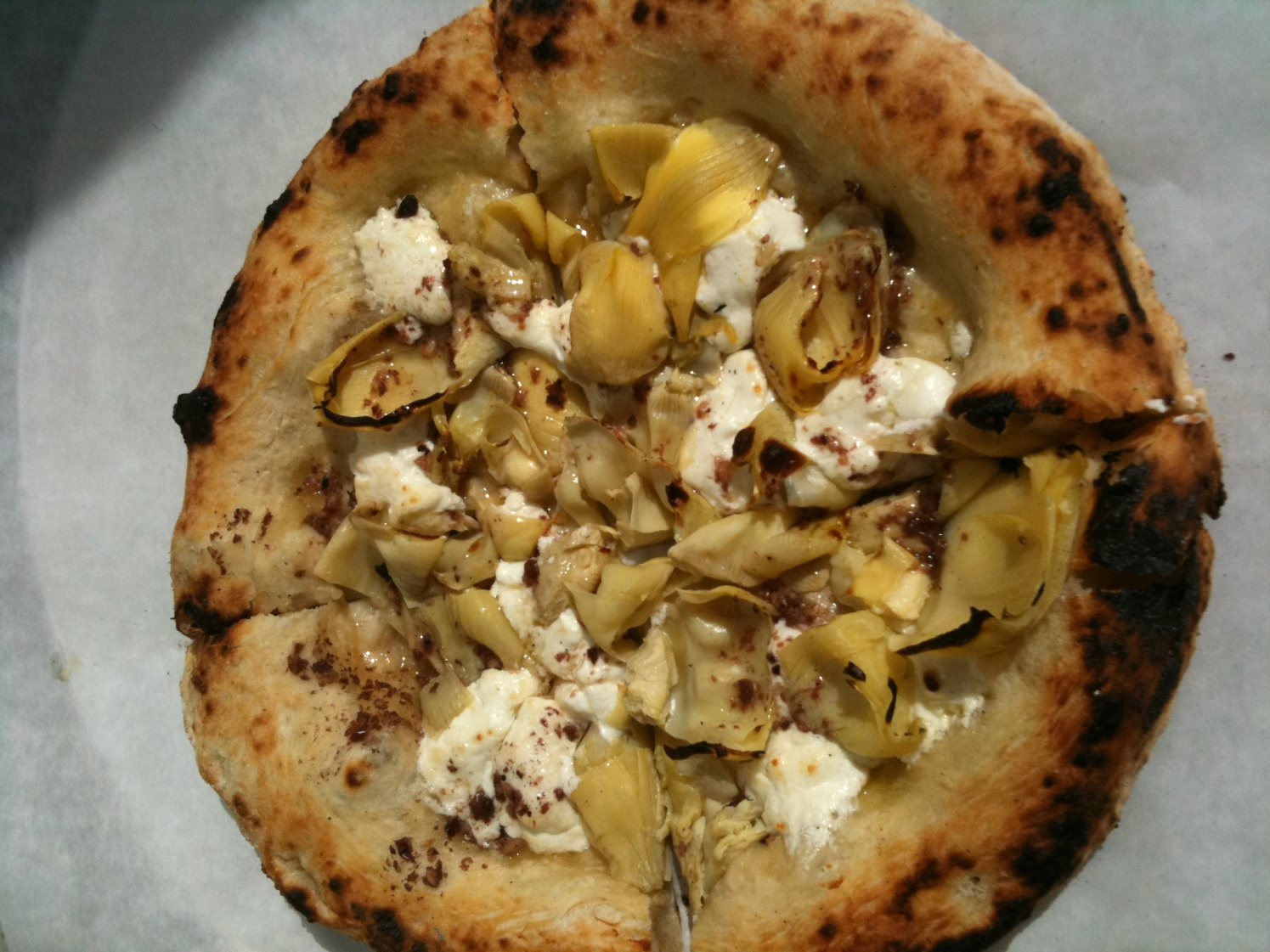 The luscious goat cheese & artichoke pizza from Pizzetteria Brunetti.