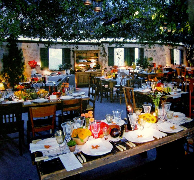 Low-key lighting and lanterns enhance the feel of a Tuscan farmhouse at Billy Joel & Katie Lee's wedding.