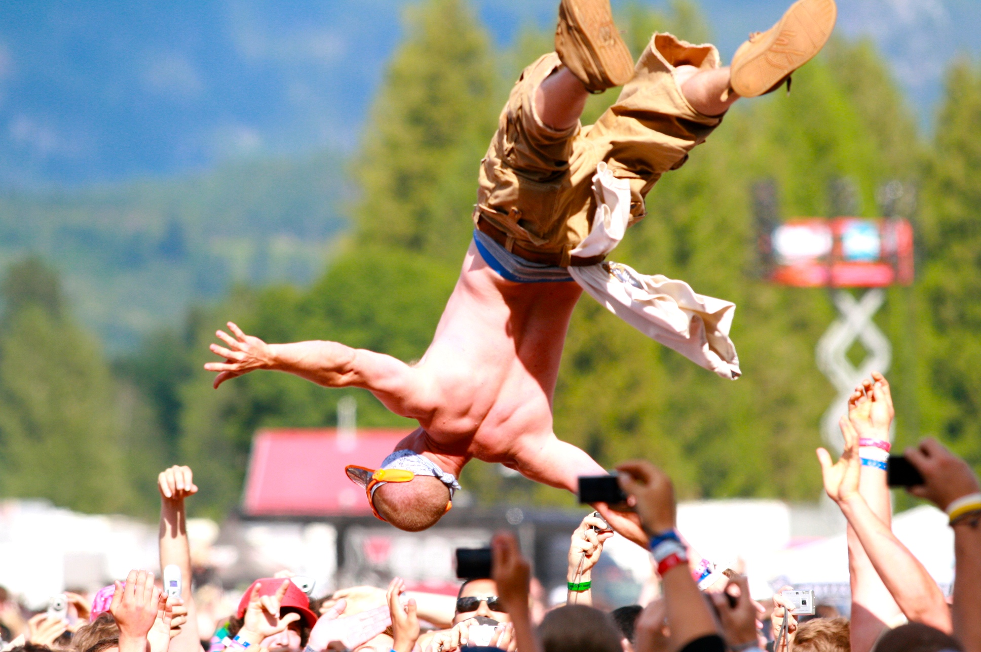 A concert-goer gets tossed in the air during the inaugural Pemberton Festival.
