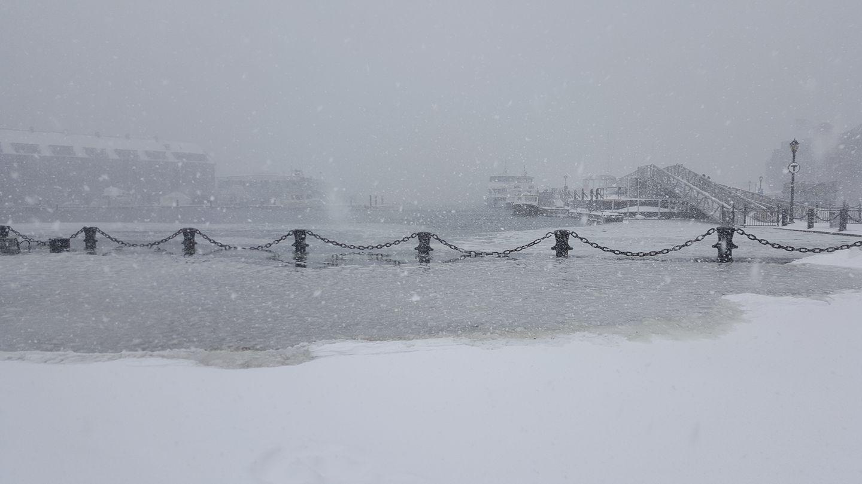 Storm surge in Christopher Columbus Park.