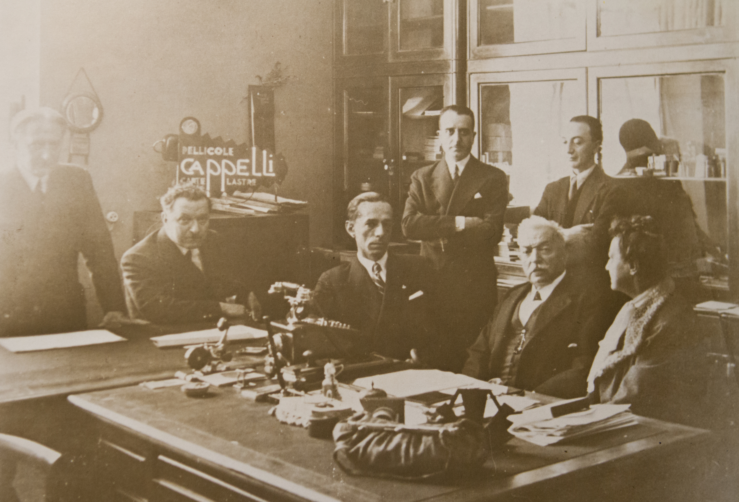 Michele Cappelli, shown seated between his wife and Franco Marmont, at the sale of Cappelli to F.I.L.M