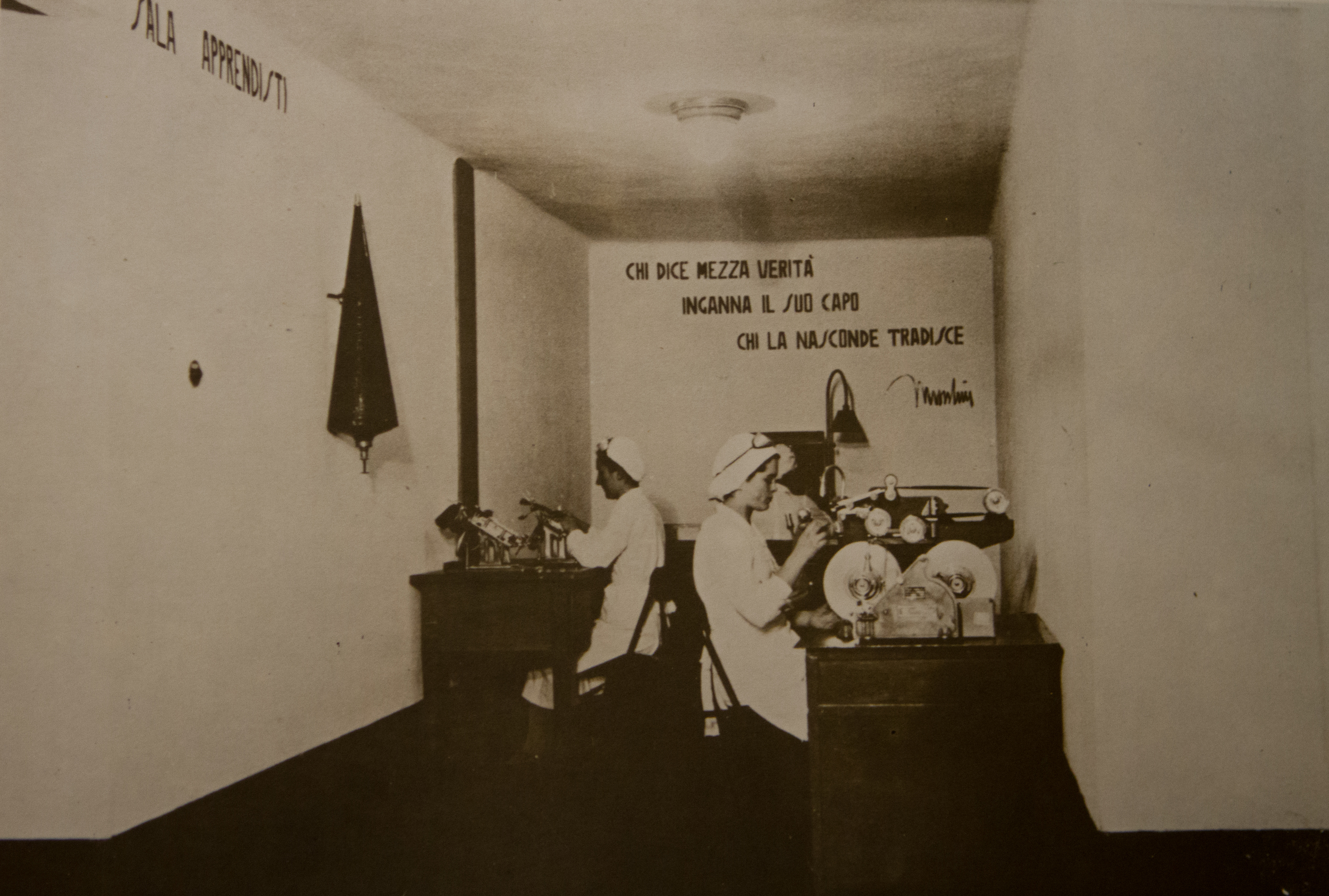 Fascist slogans on the wall inside a production room.