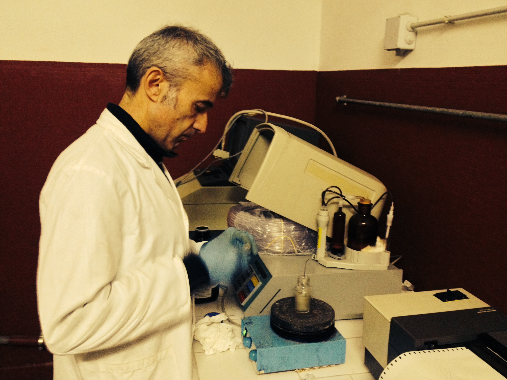 Corrado Balestra taking spectrophotometric measurements of an emulsion sample.