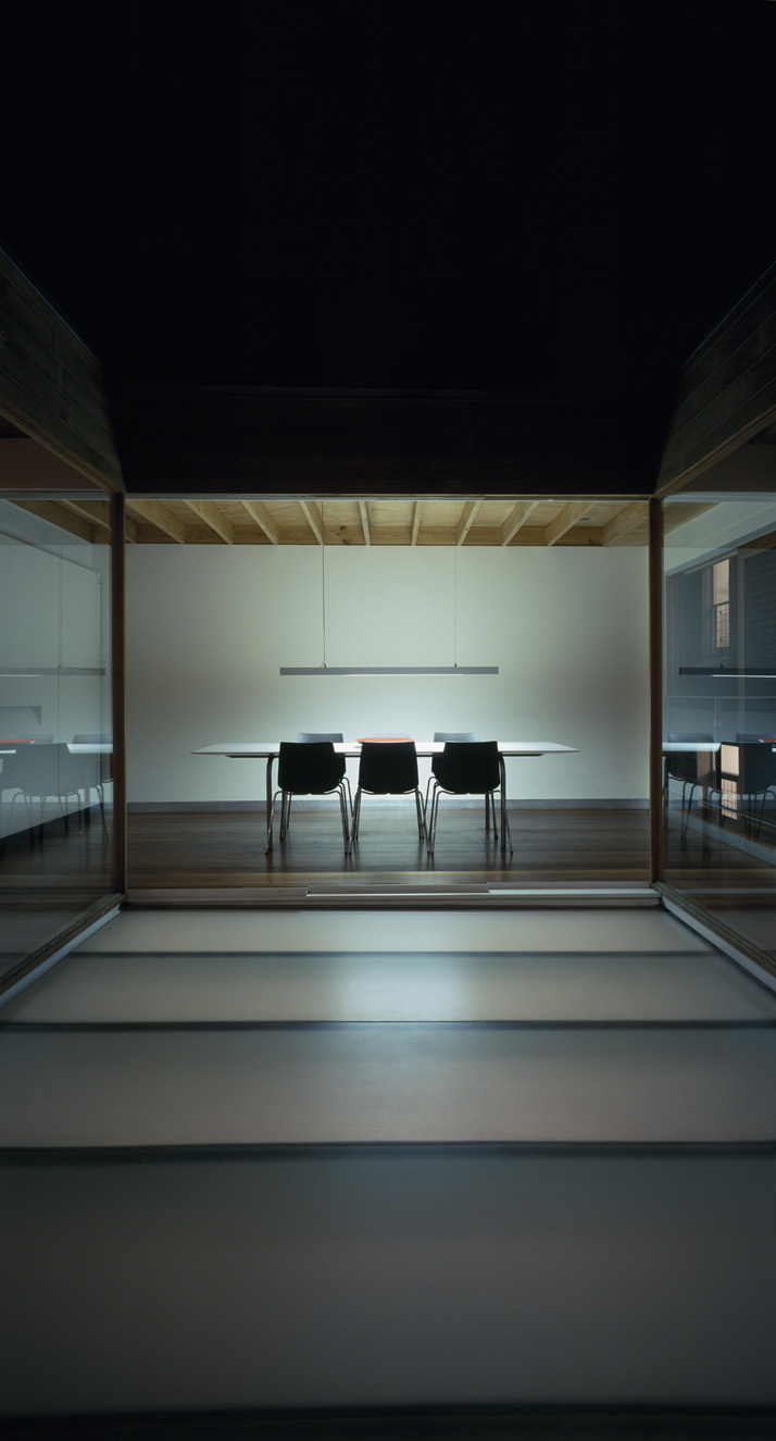 House eight- eight - glass courtyard at night