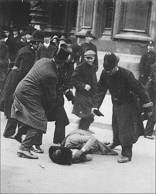 The photograph the government tried to hide. Suffragette Ada Wright collapses through police violence on Black Friday. 18/11/1910. London.