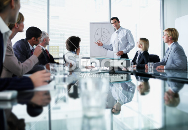 stock-photo-24379486-group-of-office-workers-in-a-boardroom-presentation.jpg