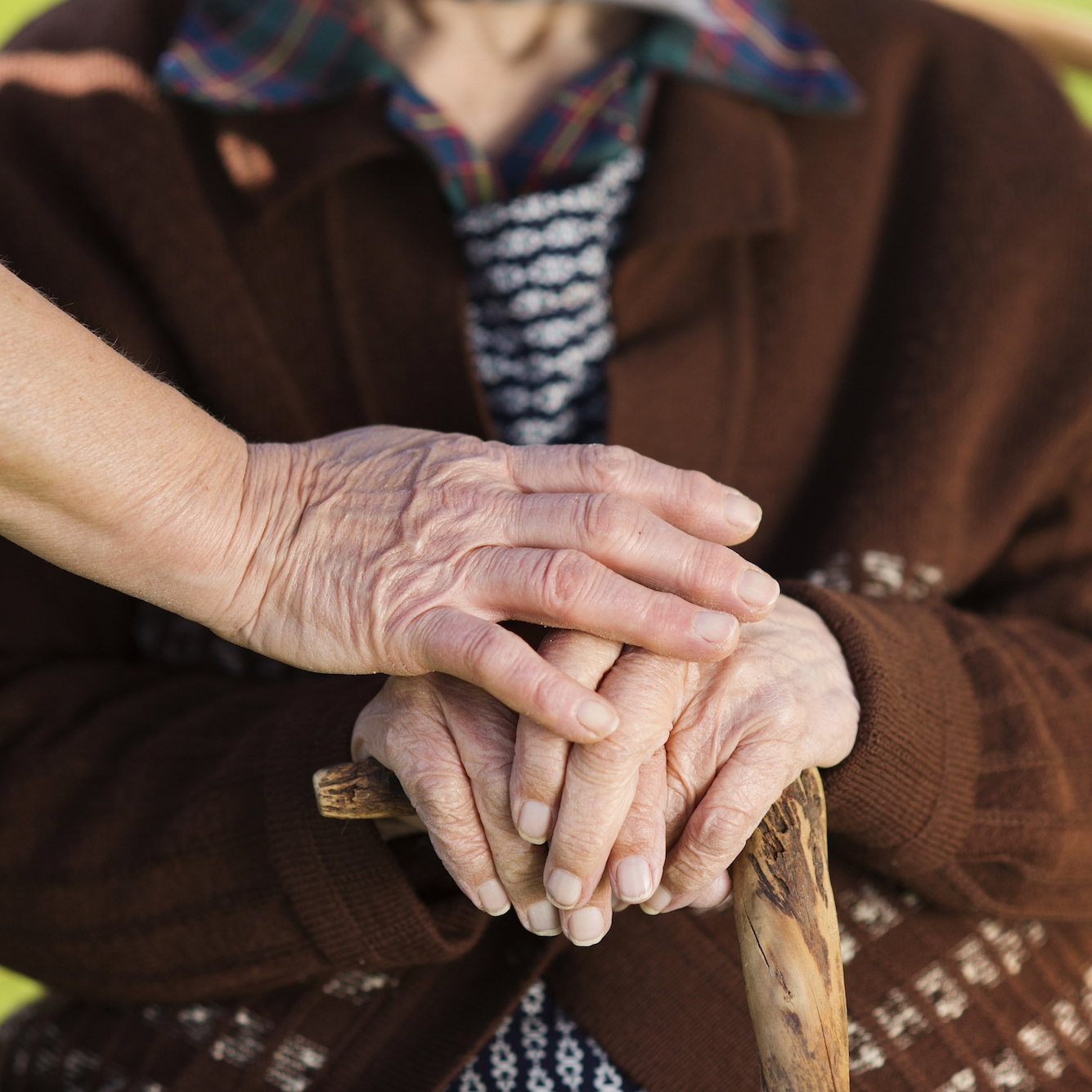 graphicstock-closeup-of-caring-woman-holding-female-seniors-hands_HAdOpB2-W.jpg