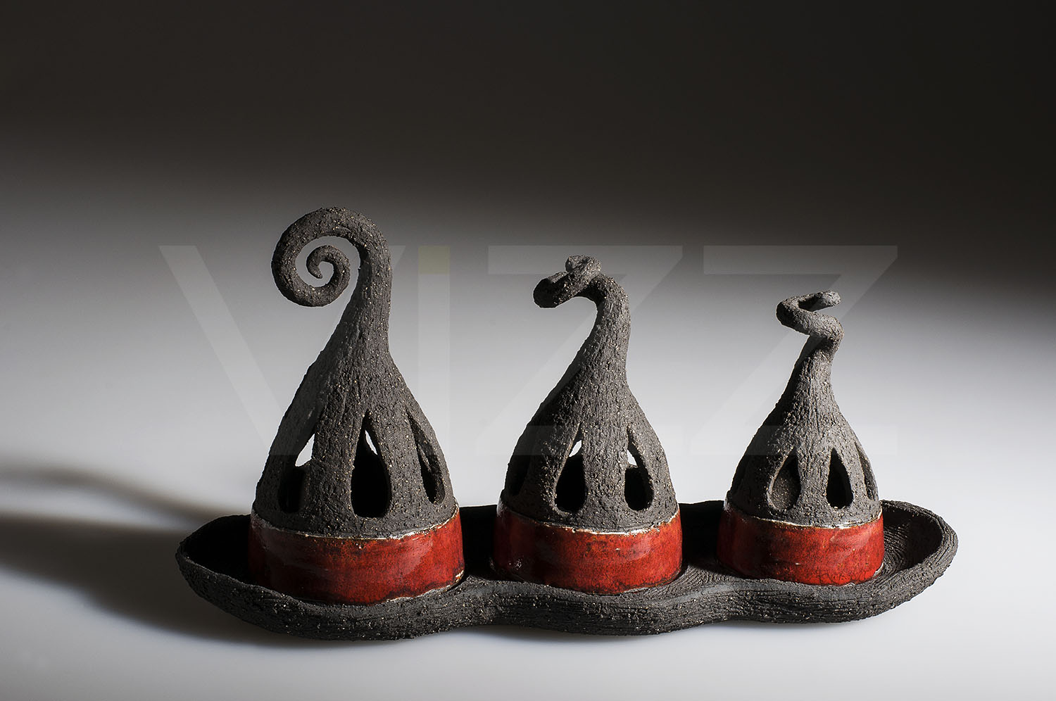 Candle Holders by Alison Hanvey. Definitely an unusual and sculptural piece.