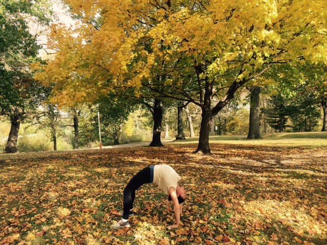 Photo taken during a morning walk through North Park of my hometown Carlisle, Iowa. The colors and morning air inspired a huge heart opening. Back-bends are nature's caffeine, bliss energy to start the day.  Photo credit: Maggie McCormick, wearing Tanya-B clothing  www.tanya-b.com