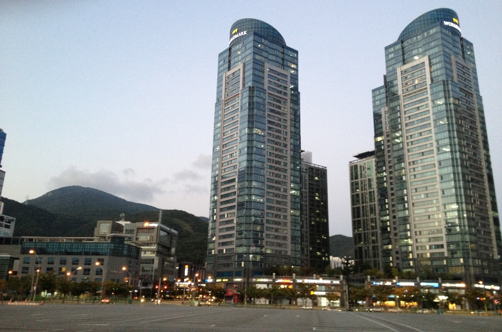 A good idea of what Busan is like; the large modern buildings of Centum City backed by picturesque green hills