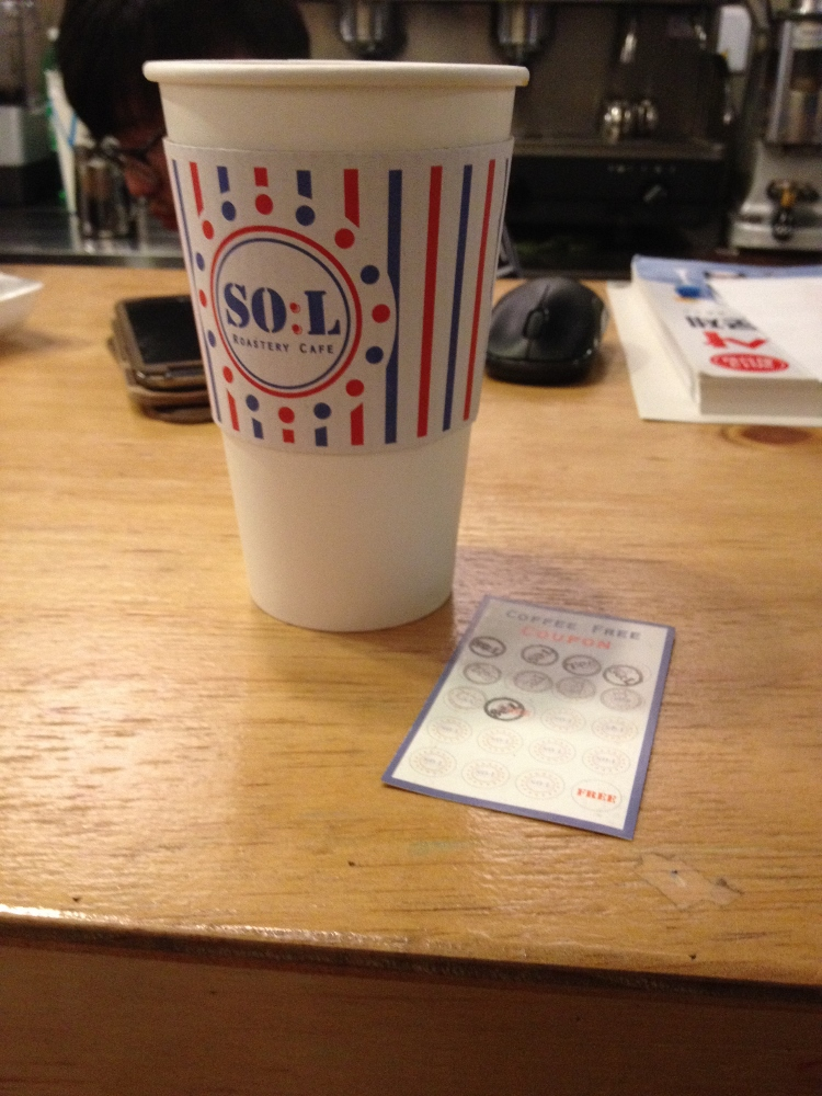 S:OL coffee and my current stamp coupon. You can see the owner's head in the background too.