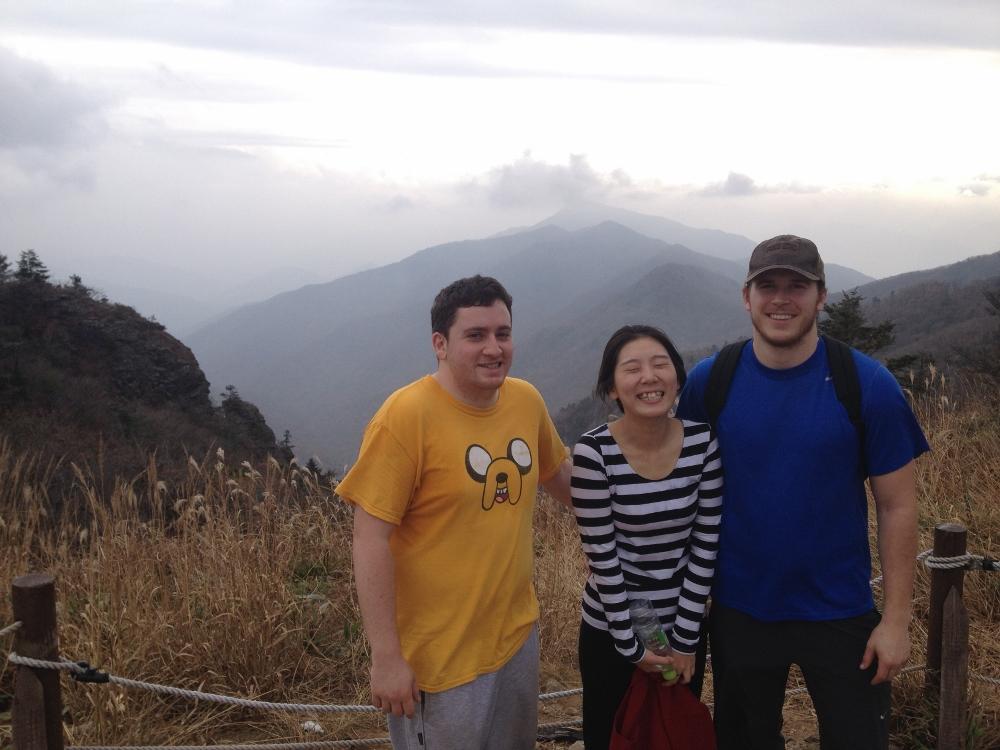 Three amigos smiling at the top