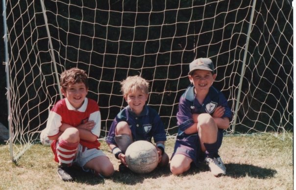 In the back garden at 15 Poio Way circa mid-90s. L-R: Me, brother Ryan, cousin Adam (Apologies to Ryan and Adam who are now both Arsenal fans and will not appreciate my spreading of this picture of them wearing Sp*rs kits.)