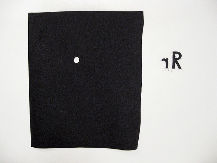 "a hole is a true 1,    2013-2014.   Industrial wool felt hand stitched with silk thread. 45"" x 50.75"""