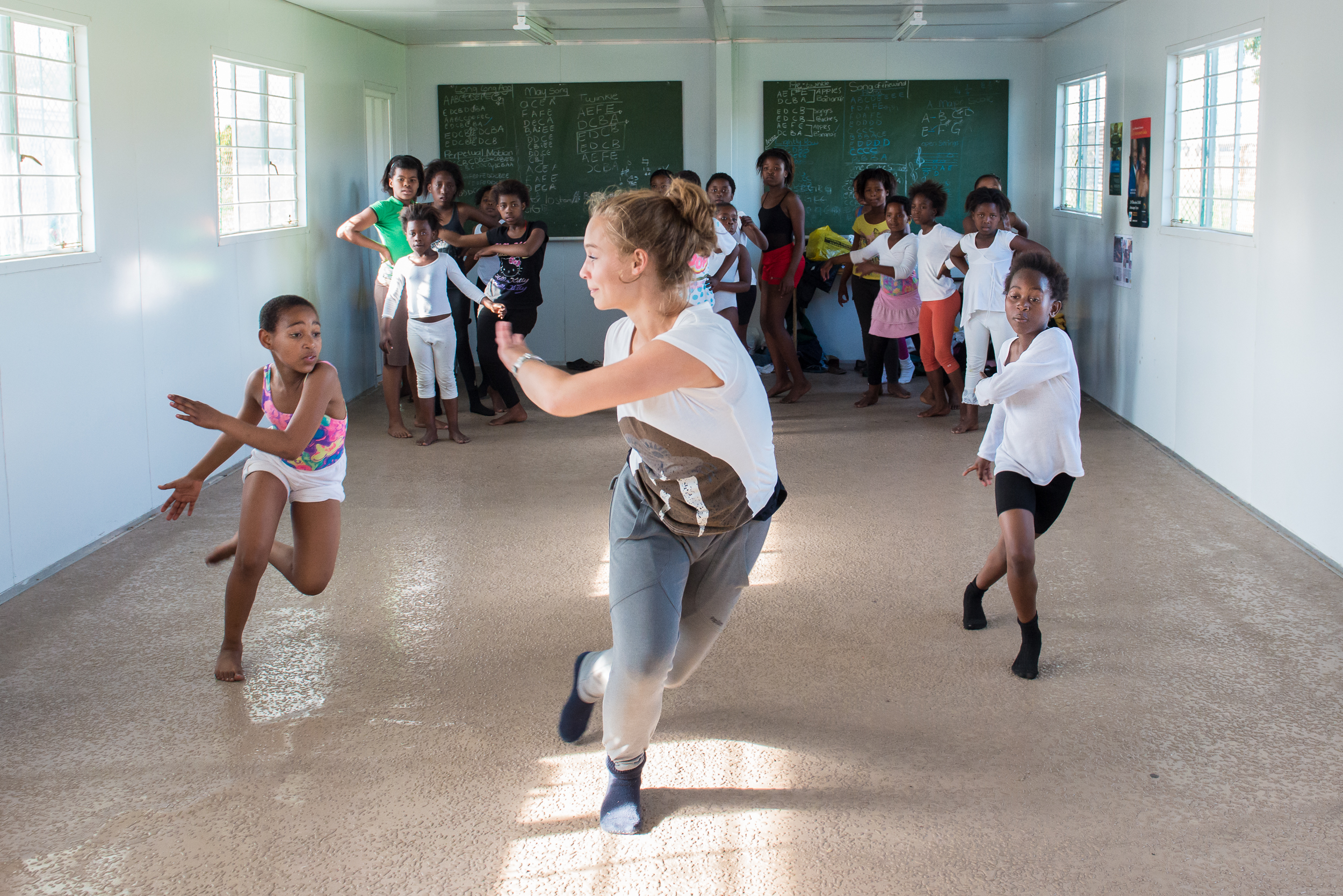 Dance for All also hosts a regular list of guest choreographers, instructors and interns. Lotte, an intern from Holland teaches a class in the township of Hlingisa.