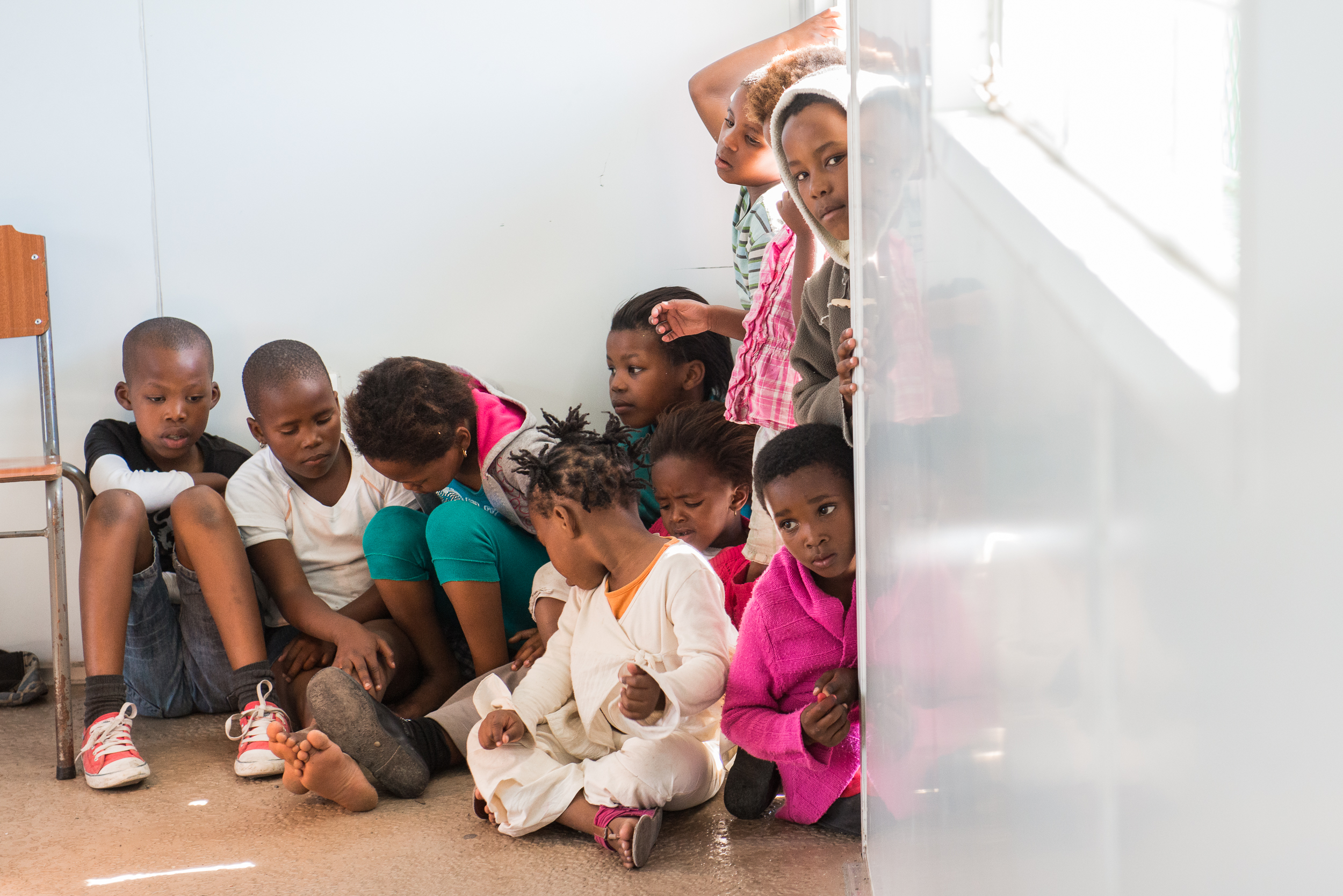 Classes in the townships become an event. Children who don't want to dance or are too young to participate often watch from the doors and windows.