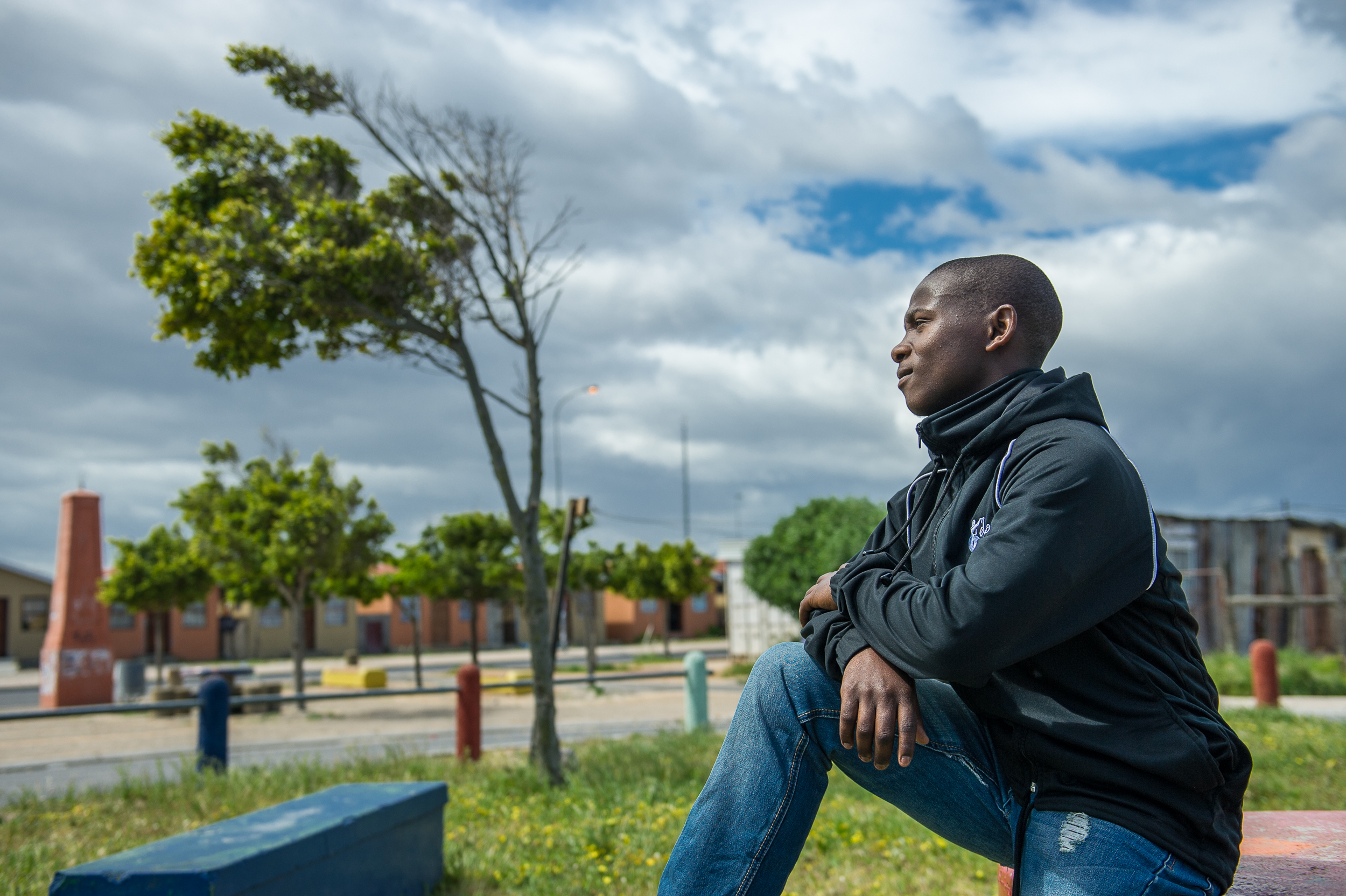 Samkile waits outside of his grandmother's house. They often struggle to make ends meet.