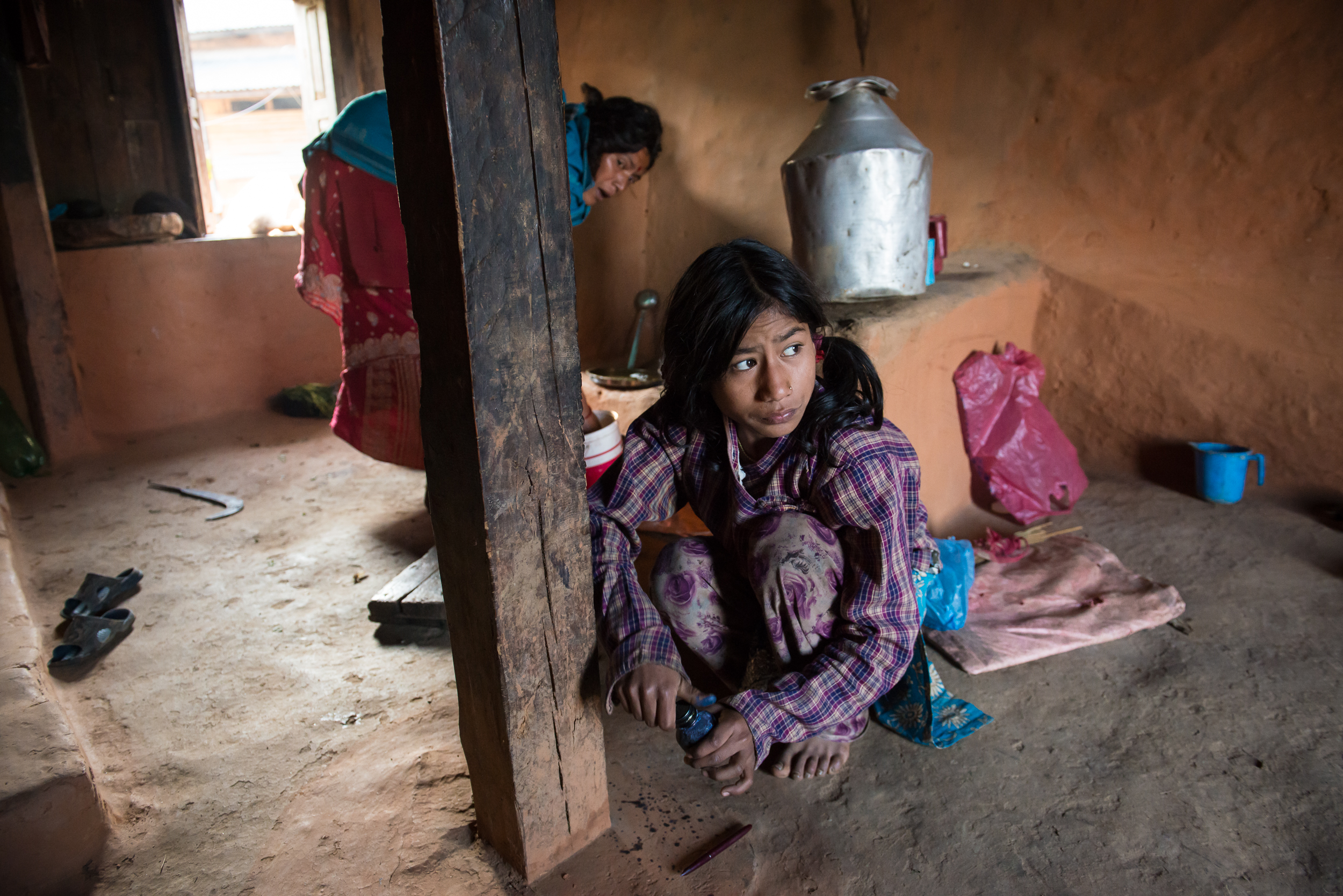 In addition to child care, Ganga and her older sister Jamuna are also responsible for cooking, laundry, and housework. Once all of those chores are finished, the girls can start on their schoolwork.