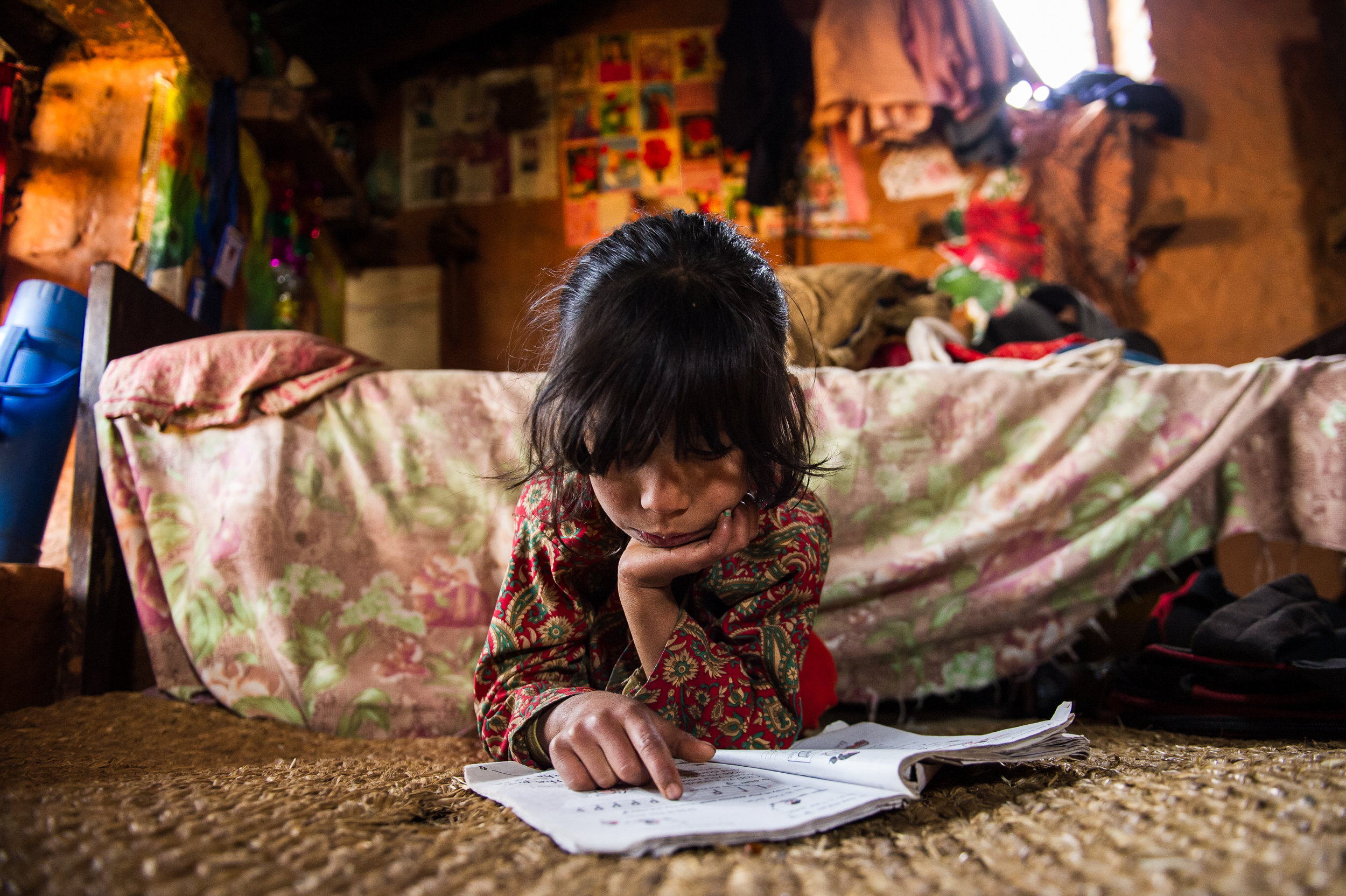 Since Jamuna and Ganga are responsible for most of the chores, Rasu, 6, has more time for homework.