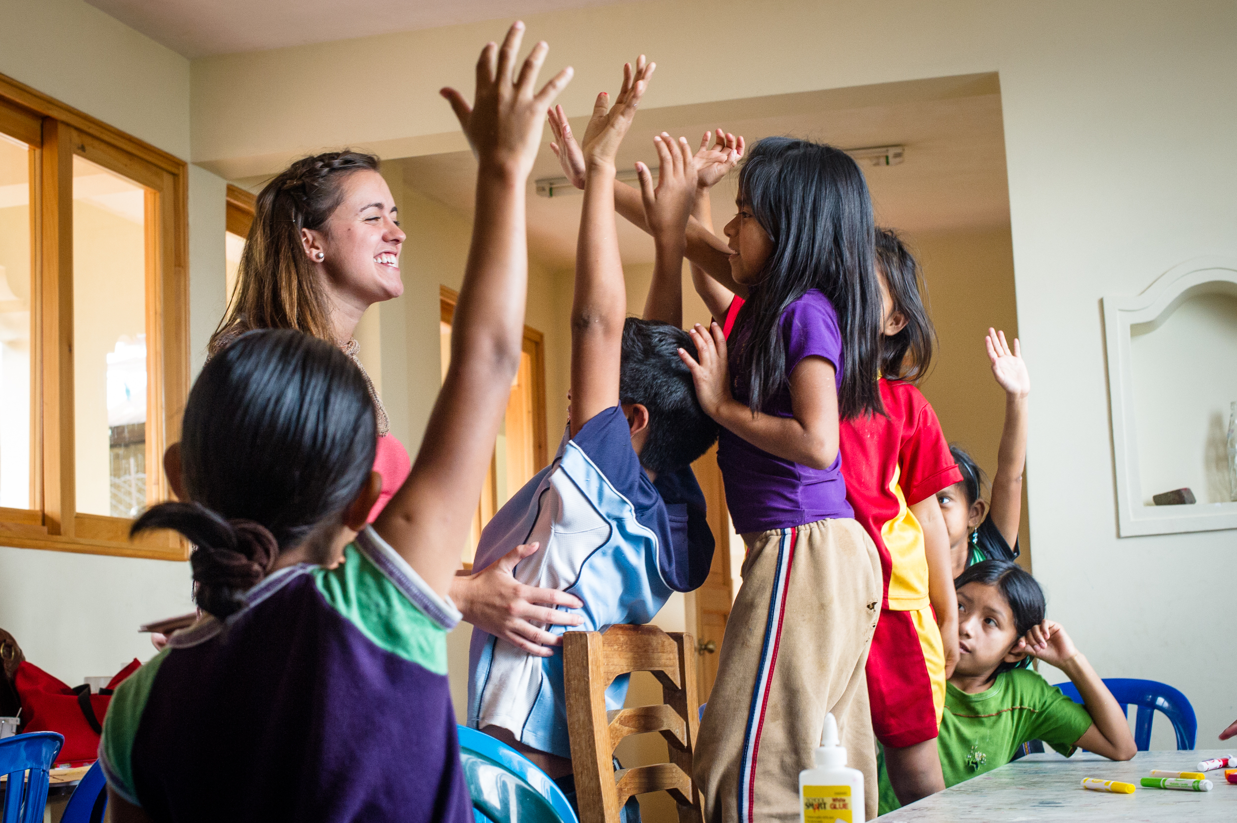 Patricia Preston, a teacher, leads an excited group of students through a lesson on why it's important to brush your teeth. The program is designed by teachers and nutritionists in the United States who volunteer to travel to Santa Cruz and work with the children.