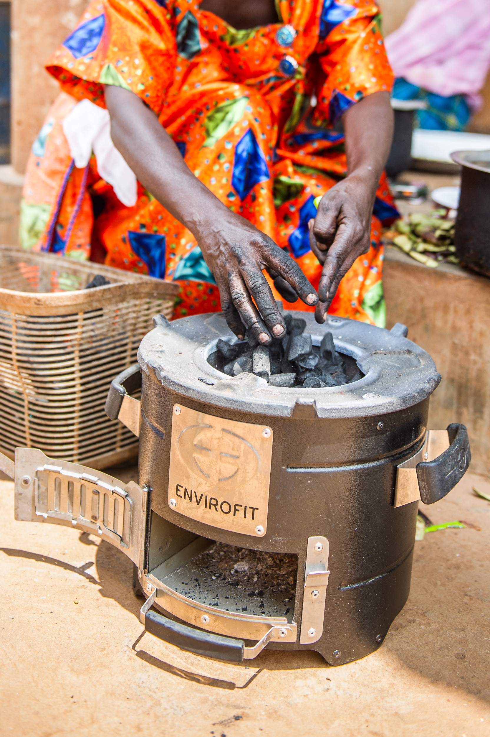The clean cookstove uses a small amount of charcoal, cutting Jane's need for fuel by 70 percent.