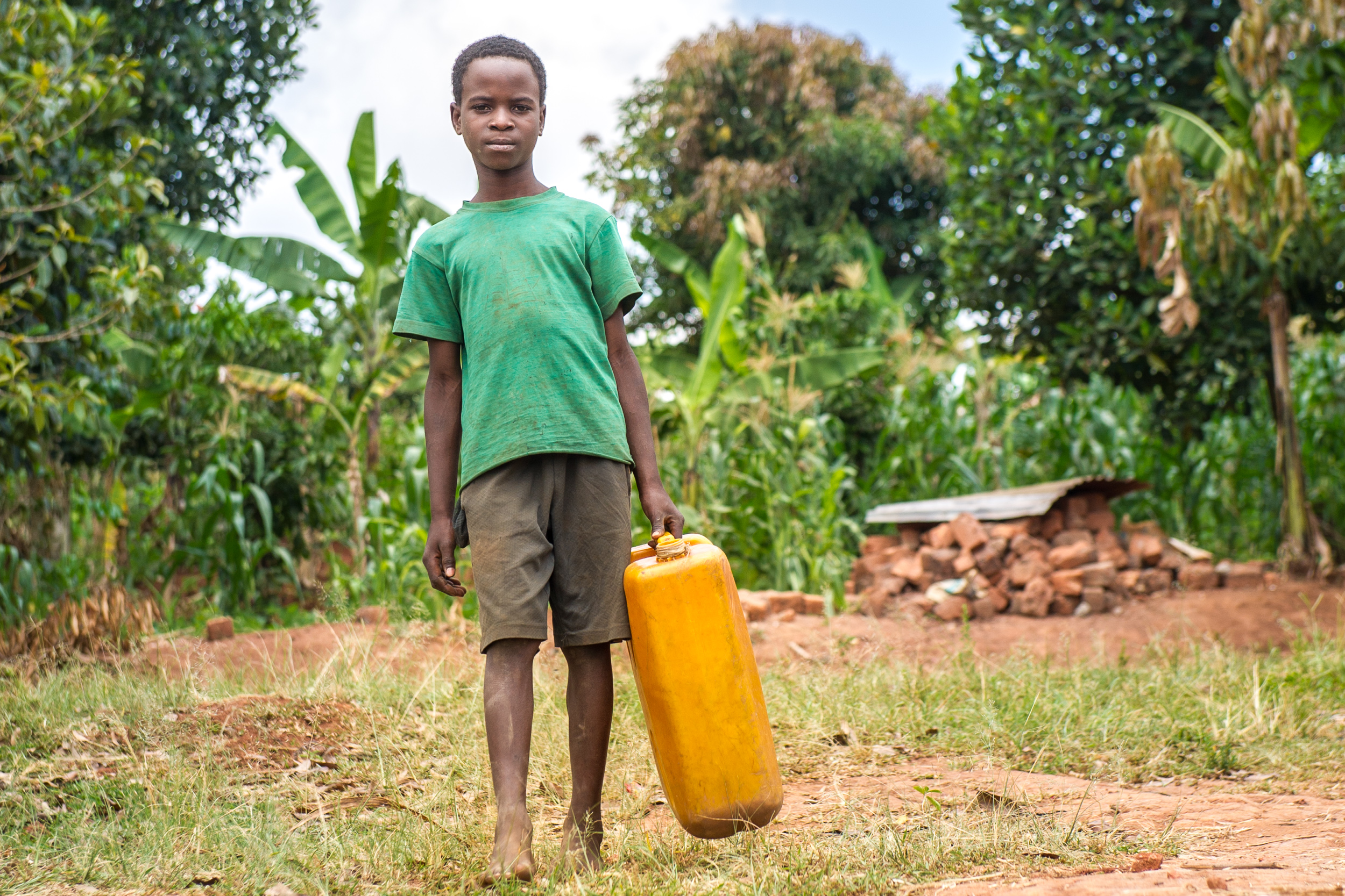 Brian, Jane's grandson, makes the hour-long round trip trek to the well every day. Even though the well's water is unsafe to drink, the family has no other options. Jane became the caretaker for her two grandchildren when their parents died.