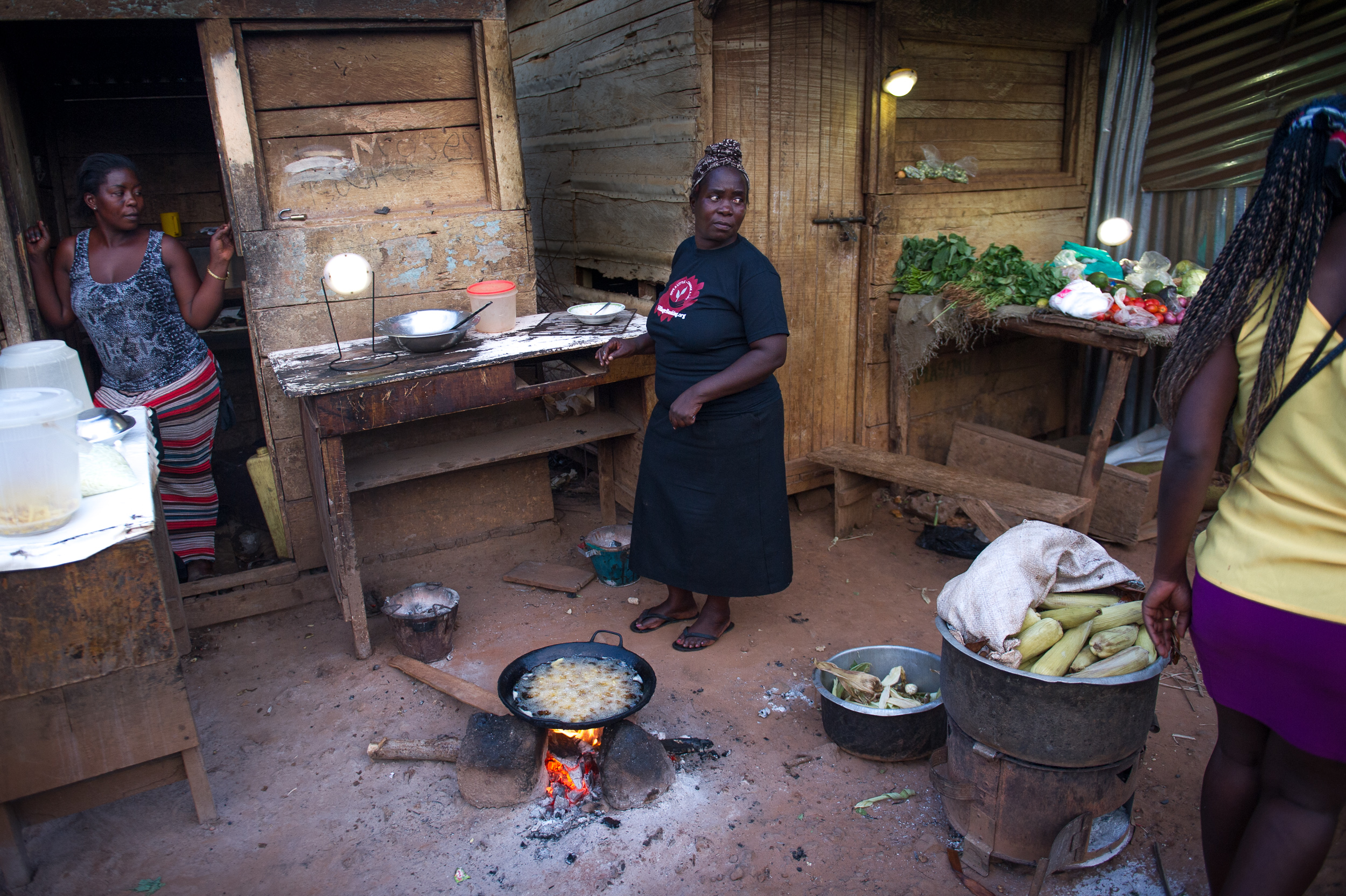 Josephine's canteen and vegetable stand is now lit by four portable solar lanterns.