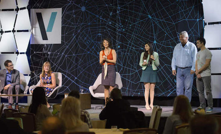Shana Rappaport of GreenBiz Group announces the winner of the 2014 VERGE Accelerate competition from the main stage.