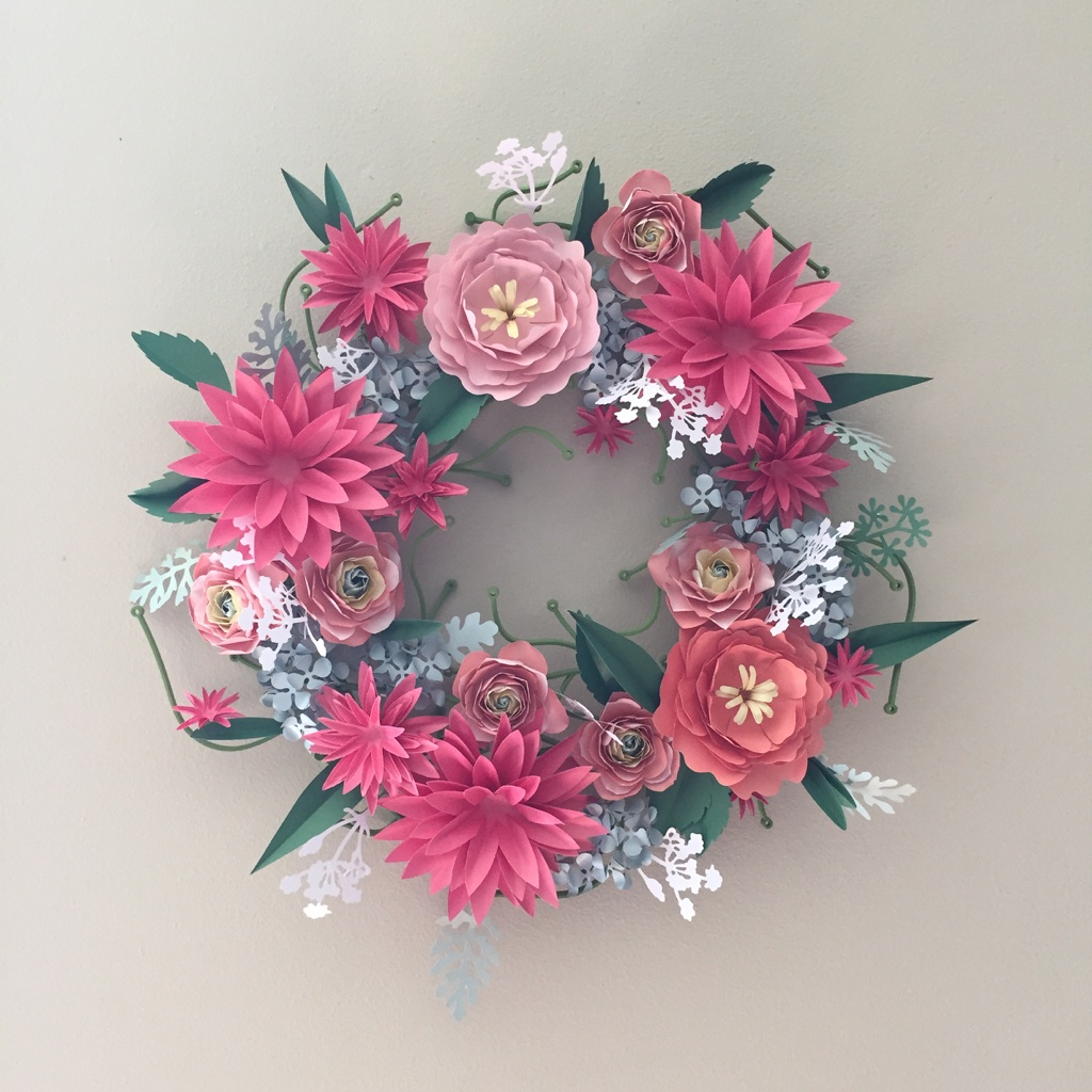 Paper flower wreath assembled from various kits