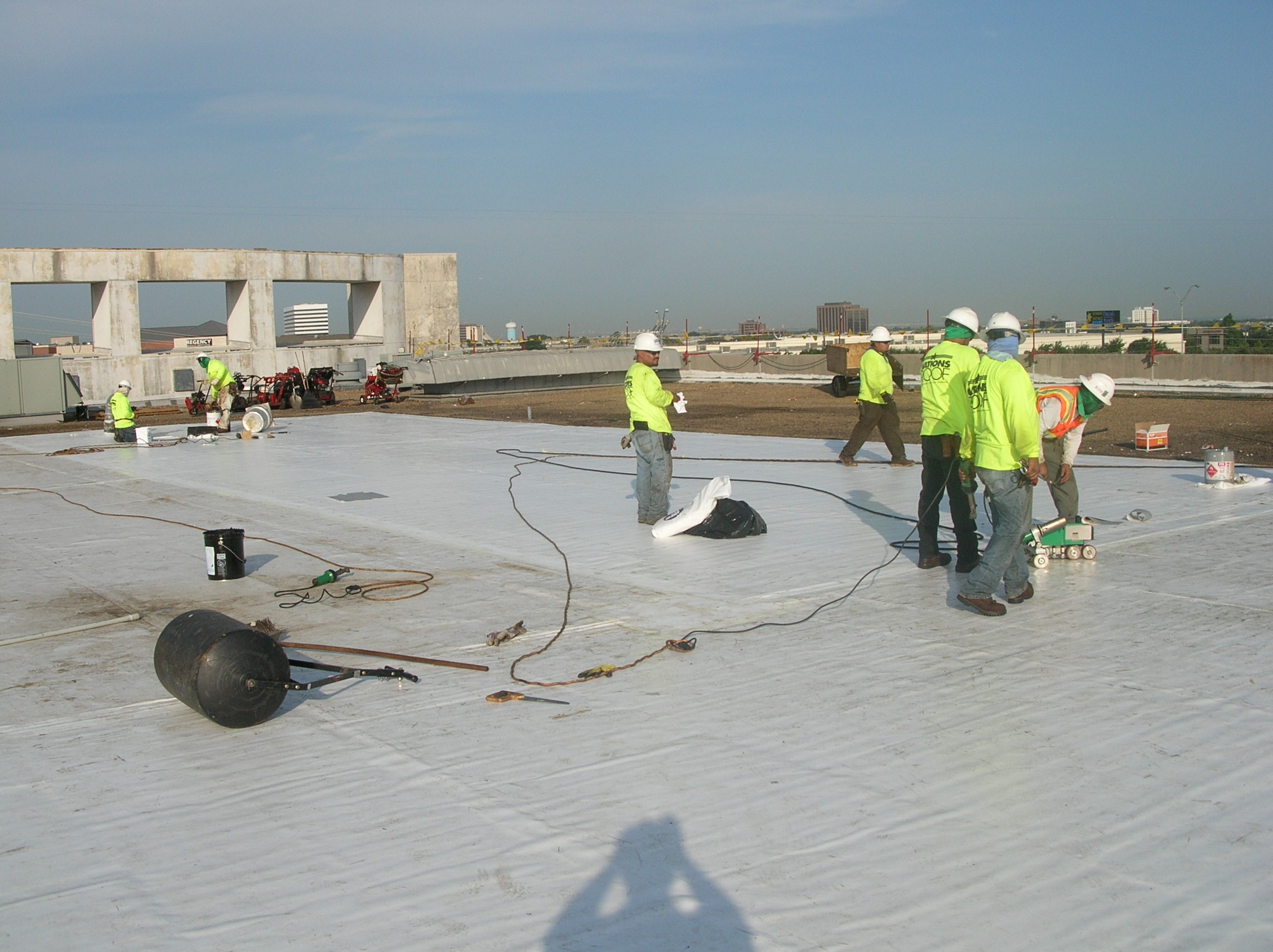 Installation of a PVC roof in progress.